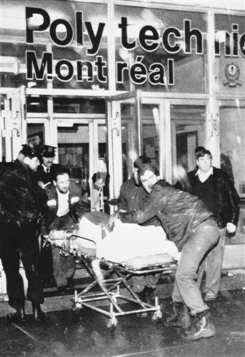 An injured is wheeled away from the University of Montreal on Wednesday, Dec. 6, 1989 after a gunman opened fire in a packed classroom. &#40;AP Photo&#41; <span class=meta>(AP Photo&#47; Anonymous)</span>