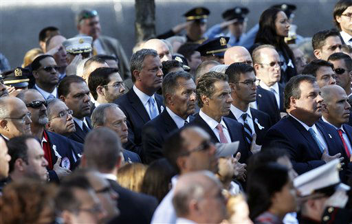 Former New York Mayor Rudolph Giuliani, far left, New York Mayor Michael Bloomberg, fifth left, New York Governor Andrew Cuomo, fourth right, and New Jersey Governor Chris Christie, second right, attend as friends and relatives of the victims of the Sept. 11 terrorist attacks on the World Trade Center attend a ceremony marking the 11th anniversary of the attacks at the National September 11 Memorial at the World Trade Center site in New York, Tuesday, Sept. 11, 2012. &#40;AP Photo&#47;Jason DeCrow&#41; <span class=meta>(AP Photo&#47; Jason DeCrow)</span>