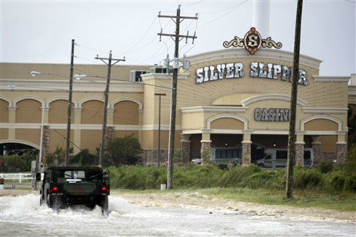 A National Guard patrol polices the Silver Slip Casino in Waveland, Miss., as Isaac&#39;s high tides and rising waves force the closing of the Gulf Coast&#39;s gaming facilities along the Mississippi Gulf Coast, Tuesday, Aug. 28, 2012.  The U.S. National Hurricane Center in Miami said Isaac became a Category 1 hurricane Tuesday with winds of 75 mph. It could get stronger by the time it&#39;s expected to reach the swampy coast of southeast Louisiana. &#40;AP Photo&#47;Rogelio V. Solis&#41; <span class=meta>(AP Photo&#47; Rogelio V. Solis)</span>