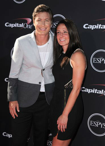 Soccer player Abby Wambach, left, and a guest arrive at the ESPY Awards on Wednesday, July 17, 2013, at Nokia Theater in Los Angeles. &#40;Photo by Jordan Strauss&#47;Invision&#47;AP&#41; <span class=meta>(Photo&#47;Jordan Strauss)</span>