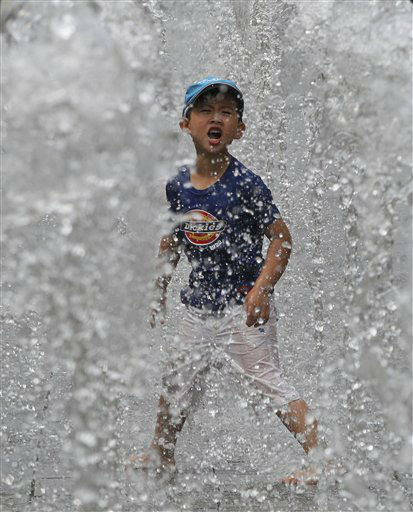 A South Korean child cools himself off by playing in a fountain in Seoul, South Korea, Wednesday, June 26, 2013. &#40;AP Photo&#47;Ahn Young-joon&#41; <span class=meta>(AP Photo&#47; Ahn Young-joon)</span>