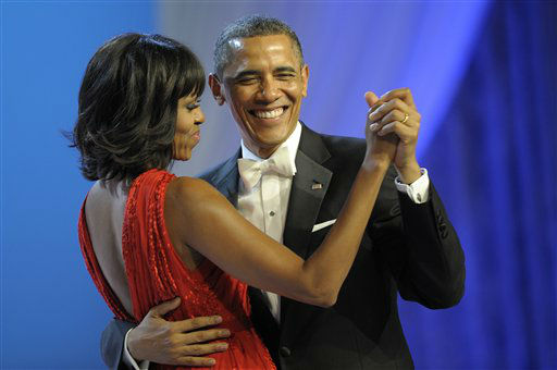 "<div class=""meta ""><span class=""caption-text "">President Barack Obama dances with first lady Michelle Obama during The Inaugural Ball at the Washignton convention center during the 57th Presidential Inauguration in Washington, Monday, Jan. 21, 2013. (AP Photo/Cliff Owen) (AP Photo/ Cliff Owen)</span></div>"