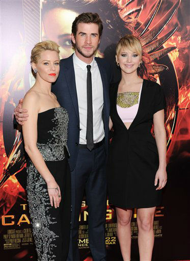 "Actors Elizabeth Banks, left, Liam Hemsworth and Jennifer Lawrence attend a special screening of ""The Hunger Games: Catching Fire"" at AMC Lincoln Square on Wednesday, Nov. 20, 2013 in New York. (Photo by Evan Agostini/Invision/AP)"