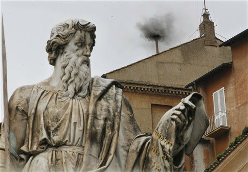 Black smoke emerges from the chimney on the Sistine Chapel as cardinals voted on the second day of the conclave to elect a pope in St. Peter&#39;s Square at the Vatican, Wednesday, March 13, 2013. In the foreground is the statue of St. Paul. &#40;AP Photo&#47;Dmitry Lovetsky&#41; <span class=meta>(AP Photo&#47; Dmitry Lovetsky)</span>