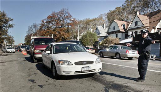 "<div class=""meta ""><span class=""caption-text "">Police direct cars in line to gas station pumps on Friday, Nov. 9, 2012 in Brooklyn, N.Y.  Police were at gas stations to enforce a new gasoline rationing plan that lets motorists fill up every other day that started in New York on Friday morning. (AP Photo/Bebeto Matthews) (AP Photo/ Bebeto Matthews)</span></div>"