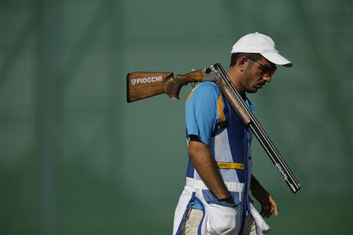 Skeet shooter Georgios Achilleos of Cyprus changes positions during training at the Royal Artillery Barracks, ahead of the start of the 2012 Summer Olympics, Thursday, July 26, 2012, in London. &#40;AP Photo&#47;Rebecca Blackwell&#41; <span class=meta>(AP Photo&#47; Rebecca Blackwell)</span>