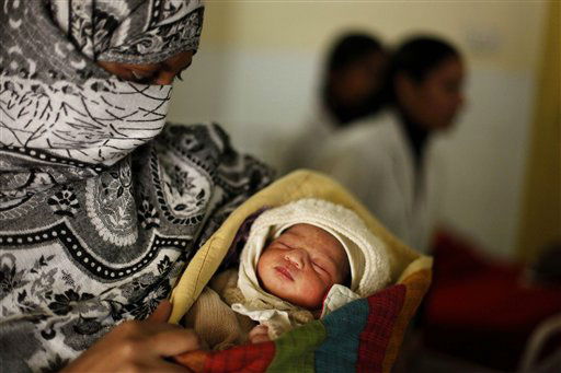 An Indian mother holds her baby, born on 12&#47;12&#47;12 at a hospital in Allahabad, India, Wednesday, Dec. 12, 2012. The date 12&#47;12&#47;12, seen as auspicious by astrologers, saw an influx of mothers to local hospitals looking to give birth on the date which won&#39;t happen again for nearly 100 years, local media reported. &#40;AP Photo&#47;Rajesh Kumar Singh&#41; <span class=meta>(AP Photo&#47; Rajesh Kumar Singh)</span>