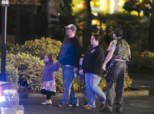 A family leaves the scene of a multiple shooting at Clackamas Town Center Mall in Clackamas, Ore., Tuesday Dec. 11, 2012. A gunman is dead after opening fire in the Portland, Ore., area shopping mall Tuesday, killing two people and wounding another, sheriff&#39;s deputies said. &#40;AP Photo&#47;Greg Wahl-Stephens&#41; <span class=meta>(AP Photo&#47; Greg Wahl-Stephens)</span>