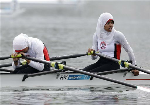 Egypt&#39;s Fatma Rashed, left, and Sara Mohamed Baraka recover after finishing last in a lightweight women&#39;s rowing double sculls repechage in Eton Dorney, near Windsor, England, at the 2012 Summer Olympics, Tuesday, July 31, 2012. &#40;AP Photo&#47;Natacha Pisarenko&#41; <span class=meta>(AP Photo&#47; Natacha Pisarenko)</span>
