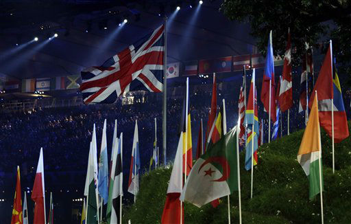 The British flag flies among those of other countries participating in the 2012 Summer Olympics  during the Opening Ceremony, Saturday, July 28, 2012, in London. &#40;AP Photo&#47;Mike Groll&#41; <span class=meta>(AP Photo&#47; Mike Groll)</span>
