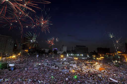 Fireworks burst over opponents of Egypt&#39;s Islamist President Mohammed Morsi in Tahrir Square in Cairo, Egypt, Tuesday, July 2, 2013. With a military deadline for intervention ticking down, protesters seeking the ouster of Egypt&#39;s Islamist president sought Tuesday to push the embattled leader further toward the edge with another massive display of people power. &#40;AP Photo&#47;Amr Nabil&#41; <span class=meta>(AP Photo&#47; Amr Nabil)</span>