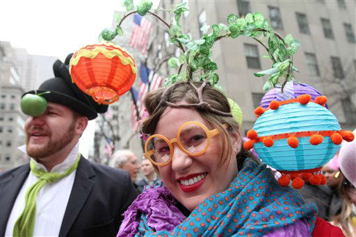 Dressed for the occasion, Brooke Biethan, of New York, right, poses for photographs as she and her brother Jay Biethan, of Boston, Mass, left, take part in the Easter Parade on New York&#39;s Fifth Avenue, Sunday, March 31, 2013. &#40;AP Photo&#47;Tina Fineberg&#41; <span class=meta>(AP Photo&#47; Tina Fineberg)</span>