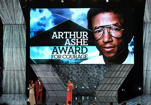 Robin Roberts speaks on stage as she accepts the Arthur Ashe award at the ESPY Awards on Wednesday, July 17, 2013, at Nokia Theater in Los Angeles. Pictured second from right is presenter LeBron James. &#40;Photo by John Shearer&#47;Invision&#47;AP&#41; <span class=meta>(Photo&#47;John Shearer)</span>
