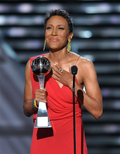 "<div class=""meta image-caption""><div class=""origin-logo origin-image ""><span></span></div><span class=""caption-text"">Television host Robin Roberts accepts the Arthur Ashe courage award at the ESPY Awards on Wednesday, July 17, 2013, at the Nokia Theater in Los Angeles. (Photo by John Shearer/Invision/AP) (Photo/John Shearer)</span></div>"