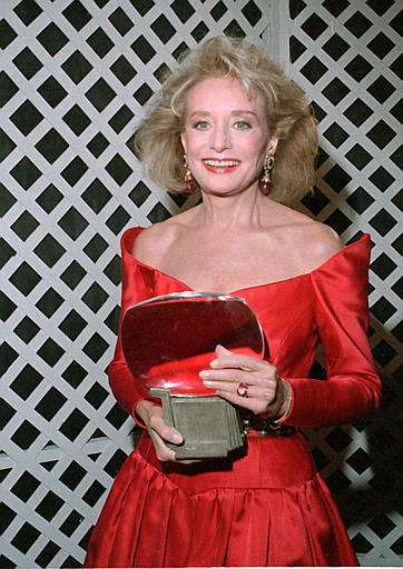Televison broadcast journalist Barbara Walters holds her induction award at the 6th annual Academy of Television Arts and Science&#39;s Hall of Fame in Los Angeles, Ca., on Jan. 7, 1990.  &#40;AP Photo&#47;Doug Sheridan&#41; <span class=meta>(AP Photo&#47; DOUG SHERIDAN)</span>