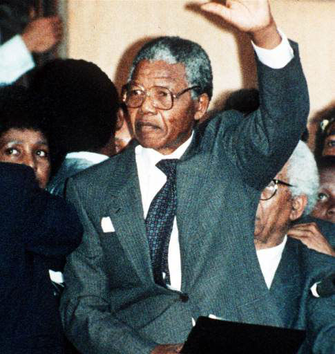 "<div class=""meta ""><span class=""caption-text "">FILE (AP) FIRST ADDRESS IN FREEDOM: ANC leader Nelson Mandela waves to thousands of his supporters in Cape Town, South Africa, during his first address after spending 27 years in jail. (AP-Photo/str/Udo Weitz/-02/11/1990-) (AP Photo/ UDO WEITZ)</span></div>"