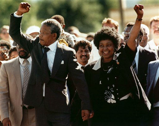 FILE - In this Sunday Feb. 11, 1990 file photo, Nelson Mandela and his then wife Winnie, walk hand in hand upon his release from Victor prison, Cape Town, South Africa.  The African National Congress leader had served over 27 years in detention. Against all odds, the party of Nelson Mandela which  has transformed a nation where just 20 years ago black South Africans could not vote, and beaches and restaurants were reserved for whites only, is celebrating its 100th anniversary in Bloemfontein Sunday Jan 8 2012. &#40;AP Photo&#47;File&#41; <span class=meta>(AP Photo&#47; GREG ENGLISH)</span>