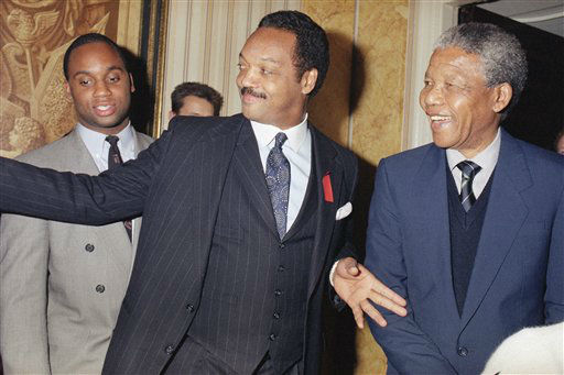 Deputy President of the African National Congress Nelson Mandela, right, meets with the Rev. Jesse Jackson when the two met during a reception for Mandela on Sunday, April 15, 1990 in a London hotel.   Mandela was in London to attend a concert in his honor at Wembley Stadium where he will make an address to a world wide television audience. The last visit to Britain by Mandela was in 1962. &#40;AP Photo&#47;Gill Allen&#41; <span class=meta>(AP Photo&#47; Gill Allen)</span>