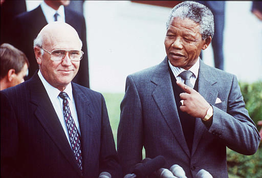 South African State President Frederik Willem de Klerk, left, and Deputy President of the African National Congress Nelson Mandela, right, prior to talks between the ANC and the South African government, Cape Town, May 2, 1990. The talks were to last 3 days. &#40;AP Photo&#47;Denis Farrel&#41; <span class=meta>(AP Photo&#47; DENIS FARREL)</span>