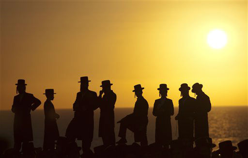 Ultra-Orthodox Jews of the Hassidic sect Vizhnitz gather on a hill overlooking the Mediterranean sea as they participate in a Tashlich ceremony in Herzeliya, Israel, Monday, Sept. 24, 2012. Tashlich, which means &#39;to cast away&#39; in Hebrew, is the practice by which Jews go to a large flowing body of water and symbolically &#39;throw away&#39; their sins by throwing a piece of bread, or similar food, into the water before the Jewish holiday of Yom Kippur, which start on Tuesday. &#40;AP Photo&#47;Ariel Schalit&#41; <span class=meta>(AP Photo&#47; Ariel Schalit)</span>