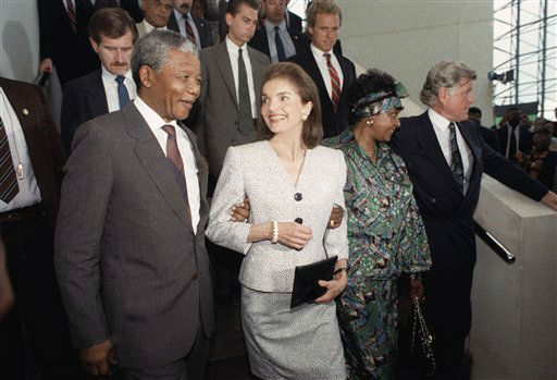 Jacqueline Kennedy Onassis casts a smiling glance at Nelson Mandela, deputy president of the African National Congress, during Mandela&#39;s visit to the John F. Kennedy Library on June 23, 1990 in Boston. The Kennedy family has been a longtime opponent of South Africa&#39;s policy of apartheid. &#40;AP Photo&#47;Peter Southwick&#41; <span class=meta>(AP Photo&#47; Peter Southwick)</span>
