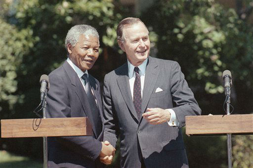 ** FILE ** In this June 25, 1990 file photo, President George H W  Bush greets African National Congress Deputy President Nelson Mandela at the White House  in Washington.  &#40;AP Photo&#47;Doug Mills, file&#41; <span class=meta>(AP Photo&#47; Dough Mills)</span>