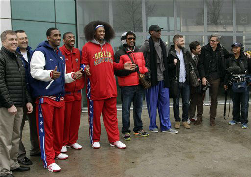Flamboyant former NBA star Dennis Rodman, fifth from right, poses with three members of the Harlem Globetrotters basketball team, in red jerseys, and a production crew for the media upon arrival at Pyongyang Airport, North Korea, Tuesday, Feb. 26, 2013. Rodman known as &#34;The Worm&#34; arrived in Pyongyang, becoming an unlikely ambassador for sports diplomacy at a time of heightened tensions between the U.S. and North Korea. &#40;AP Photo&#47;Kim Kwang Hyon&#41; <span class=meta>(AP Photo&#47; Kim Kwang Hyon)</span>