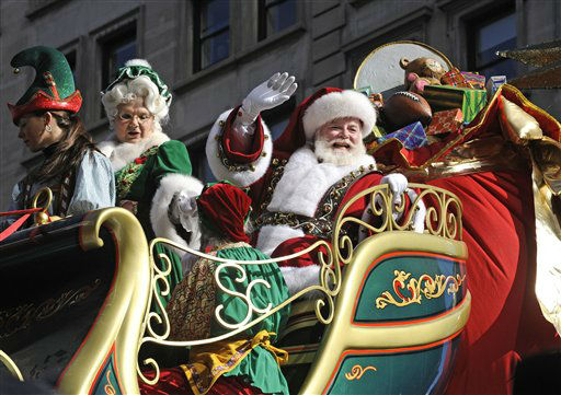 Santa and Mrs. Claus wave to the crowd at Herald Square during the 86th annual Macy&#39;s Thanksgiving Day Parade,Thursday, Nov 22, 2012, in New York &#40;AP Photo&#47; Louis Lanzano&#41; <span class=meta>(AP Photo&#47; Louis Lanzano)</span>