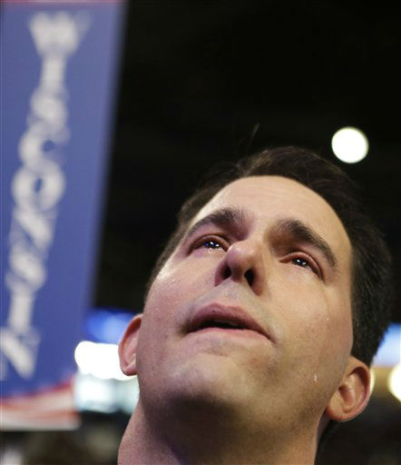 Wisconsin Gov. Scott Walker cries as Republican vice presidential nominee, Rep. Paul Ryan addresses the Republican National Convention in Tampa, Fla., on Wednesday, Aug. 29, 2012.  &#40;AP Photo&#47;David Goldman&#41; <span class=meta>(AP Photo&#47; David Goldman)</span>