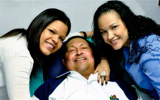 FILE - In this file photo released on Feb. 15, 2013 by Miraflores Presidential Press Office, Venezuela&#39;s President Hugo Chavez, center, poses for a photo with his daughters, Maria Gabriela, left, and Rosa Virginia at an unknown location in Havana, Cuba, Thursday, Feb. 14, 2013. Venezuela&#39;s government says that President Hugo Chavez&#39;s respiratory problems have gotten worse and that the ailing leader is in &#34;very delicate&#34; condition. Venezuela&#39;s Communications Minister Ernesto Villegas said late Monday, March 4, 2013, in a statement read on national television that the cancer-stricken socialist leader has a &#34;severe infection.&#34; &#40;AP Photo&#47;Miraflores Presidential Press Office, File&#41; <span class=meta>(AP Photo&#47; Uncredited)</span>