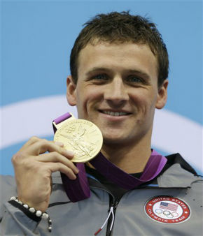 "<div class=""meta ""><span class=""caption-text "">United States' Ryan Lochte poses with his gold medal for the men's 400-meter individual medley swimming final at the Aquatics Centre in the Olympic Park during the 2012 Summer Olympics in London, Saturday, July 28, 2012. (AP Photo/Michael Sohn) (AP Photo/ Michael Sohn)</span></div>"