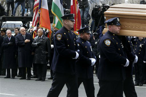 Mayor Michael Bloomberg, left, and former Mayors Rudolph Giuliani, second from left, and David Dinkins, third from left, put their hands over their hearts as a casket containing the body of former New York City Mayor Ed Koch leaves a synagogue after his funeral in New York, Monday, Feb. 4, 2013. Koch was remembered as the quintessential New Yorker during a funeral that frequently elicited laughter, recalling his famous one-liners and amusing antics in the public eye.  &#40;AP Photo&#47;Seth Wenig&#41; <span class=meta>(AP Photo&#47; Seth Wenig)</span>