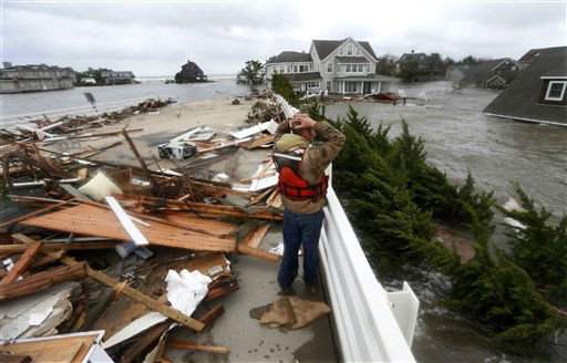 Brian Hajeski, 41, of Brick, N.J., reacts as he looks at debris of a home that washed up on to the Mantoloking Bridge the morning after superstorm Sandy rolled through, Tuesday, Oct. 30, 2012, in Mantoloking, N.J. Sandy, the storm that made landfall Monday, caused multiple fatalities, halted mass transit and cut power to more than 6 million homes and businesses. &#40;AP Photo&#47;Julio Cortez&#41; <span class=meta>(AP Photo&#47; Julio Cortez)</span>