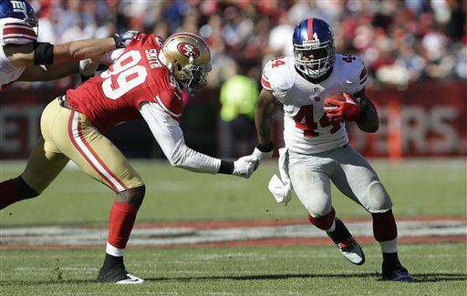 New York Giants running back Ahmad Bradshaw &#40;44&#41; runs past San Francisco 49ers linebacker Aldon Smith &#40;99&#41; during the third quarter of an NFL football game in San Francisco, Sunday, Oct. 14, 2012. &#40;AP Photo&#47;Marcio Jose Sanchez&#41; <span class=meta>(AP Photo&#47; Marcio Jose Sanchez)</span>