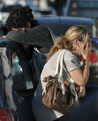 "<div class=""meta ""><span class=""caption-text "">ALTERNATIVE CROP OF XSI108.- Relatives of victims react as they wait for news near the Kiss nightclub in Santa Maria city,  Rio Grande do Sul state, Brazil, Sunday, Jan. 27, 2013.  According to police more than 200 died in the devastating nightclub fire in southern Brazil.  Officials say the fire broke out at the club while a band was performing. (AP Photo/Ronald Mendes-Agencia RBS) (AP Photo/ Ronald Mendes)</span></div>"