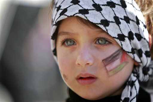 A girl with the Palestinian flag painted  on her face attends a rally supporting the Palestinian UN bid for observer state status, in the West bank city of Ramallah, Thursday, Nov. 29, 2012. The Palestinians are certain to win U.N. recognition as a state on Thursday but success could exact a high price: delaying an independent state of Palestine because of Israel&#39;s vehement opposition. &#40;AP Photo&#47;Majdi Mohammed&#41; <span class=meta>(AP Photo&#47; Majdi Mohammed)</span>