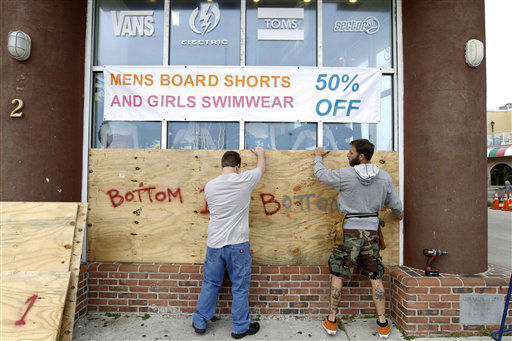 ADDS NAME OF STORE MANAGER - Store manager L.P. Cyburt, right, gets help boarding up the windows of the business as Hurricane Sandy approaches the Atlantic Coast, in Ocean City, Md., on Saturday, Oct. 27, 2012. &#40;AP Photo&#47;Jose Luis Magana&#41; <span class=meta>(AP Photo&#47; Jose Luis Magana)</span>