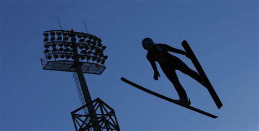 Germany's Katharina Althaus soars through the air during a women's ski jumping training session at the 2014 Winter Olympics, Saturday, Feb. 8, 2014, in Krasnaya Polyana, Russia. (AP Photo/Matthias Schrader)