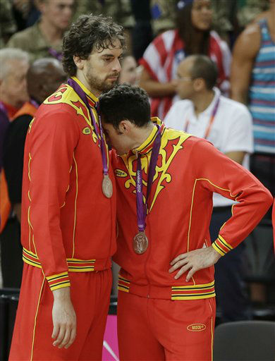 Spain&#39;s Pau Gasol, left, and Rudy Fernandez react after getting their silver medal following a ceremony at the 2012 Summer Olympics, Sunday, Aug. 12, 2012, in London. &#40;AP Photo&#47;Matt Slocum&#41; <span class=meta>(AP Photo&#47; Matt Slocum)</span>