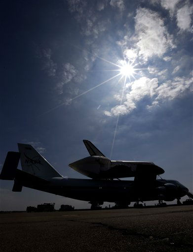 Space shuttle Endeavour sits atop the shuttle aircraft carrier after landing Wednesday, Sept. 19, 2012, at Ellington Field in Houston. Endeavour is making a final trek across the country to the California Science Center in Los Angeles, where it will be permanently displayed. &#40;AP Photo&#47;David J. Phillip <span class=meta>(AP Photo&#47; David J. Phillip)</span>