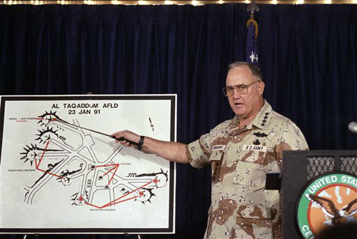 U.S. Army General H. Norman Schwarzkopf, commander of allied forces in Operation Desert Storm, points to a chart of Iraq?s Al Taqaddum Airfield damaged by allied bombing raids in Operation Desert Storm. Schwarzkopf was speaking at a military briefing on Wednesday, Jan. 30, 1991 in the Saudi Arabian capitol. &#40;AP Photo&#47;John Gaps III&#41; <span class=meta>(AP Photo&#47; John Gaps III)</span>