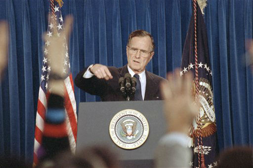 President George H.W. Bush calls on a questioner during a news conference in briefing room of White House in Washington on Tuesday, Feb. 5, 1991. The president said that he is sending Defense Secretary Dick Cheney and Gen. Colin Powell to the Persian Gulf war zone this week for &#34;first hand status report&#34; on a conflict he said is &#34;going very well indeed.&#34; &#40;AP Photo&#47;Ron Edmonds&#41; <span class=meta>(AP Photo&#47; Ron Edmonds)</span>