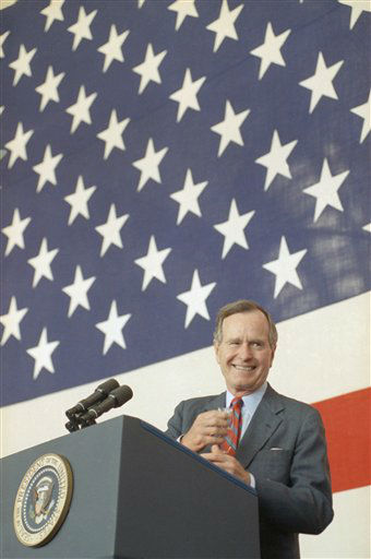 President George H.W. Bush as he addresses the Air War College troops at Maxwell Air Force Base in Montgomery, Ala., on Saturday, April 13, 1991. Bush vowed to provide massive relief to Kurdish refugees in Iraq but pledged that no American soldier will be &#34;shoved into a civil war in Iraq that&#39;s been going on for ages.&#34; &#40;AP Photo&#47;Barry Thumma&#41; <span class=meta>(AP Photo&#47; Barry Thumma)</span>
