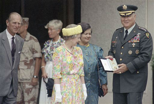 Gen. Norman Schwarzkopf stands with his wife Brenda, center, as he displays the medal presented to him by Queen Elizabeth II, left, in Tampa, Fla., Monday, May 20, 1991. The award is highest honor Britain can bestow on a foreigner. The Queen gave the general the title of honorary Knight Commander in the Military Division of the most honorable Order of the Bath. &#40;AP Photo&#47;Scott Iskowitz&#41; <span class=meta>(AP Photo&#47; Scott Iskowitz)</span>