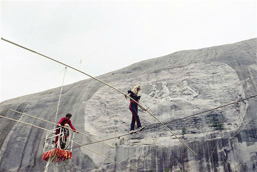 Angel Wallenda of Tioga, Pa., makes her first wire walk in a year in front of the carving of Confederate leaders on the face of Stone Mountain, Georgia on Sept. 20, 1991. Her husband Steve and five-year-old son Steven II watch left. She has a prosthetic leg that replaced the limb she lost to cancer. &#40;AP Photo&#47;Charles Kelly&#41; <span class=meta>(AP Photo&#47; Charles Kelly)</span>