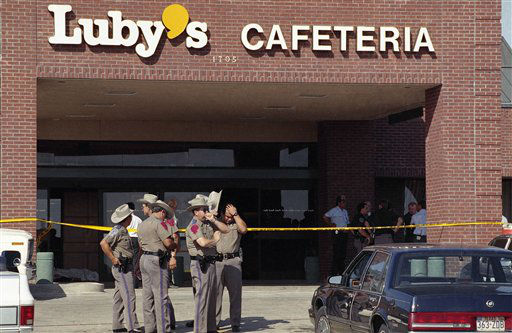 Police officers gather outside Luby&#39;s Cafeteria in Killeen, Texas, at the scene where a gunman killed 23 people including himself, with semi-automatic gunfire during lunchtime on Wednesday, Oct. 16, 1991. It was the deadliest mass shooting in U.S. history.  &#40;AP Photo&#47;Rick McFarland&#41; <span class=meta>(AP Photo&#47; Rick McFarland)</span>