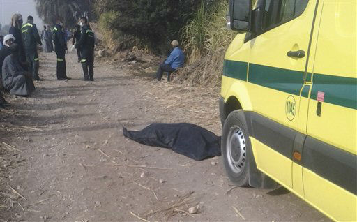 "<div class=""meta image-caption""><div class=""origin-logo origin-image ""><span></span></div><span class=""caption-text"">A victim of a ballon accident is seen in a body bag lying on a dirt road near the scene of a crash outside al-Dhabaa village just west of the city of Luxor, 510 kilometers (320 miles) south of Cairo, Egypt, Tuesday, Feb. 26, 2013. A hot air balloon flying over Egypt's ancient city of Luxor caught fire and crashed into a sugar cane field on Tuesday, killing at least 19 foreign tourists, a security official said. (AP Photo/Hagag Salama) (AP Photo/ Hagag Salama)</span></div>"