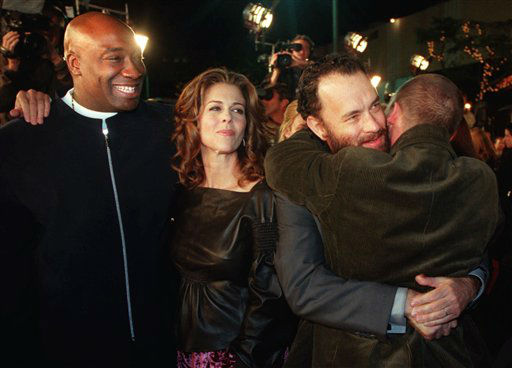 FILE - In this Monday, Dec. 6, 1999 file photo, Michael Clarke Duncan, left, watches as Tom Hanks, second from right, hugs fellow cast member Doug Hutchison as his wife Rita Wilson looks on at the premiere of &#34;The Green Mile&#34; in the Westwood section of Los Angeles. Duncan has died at the age of 54 on Monday, Sept. 3, 2012 in a Los Angeles hospital after nearly two months of treatment following a July 13, 2012 heart attack, his fiancee, the Rev. Omarosa Manigault, said. &#40;AP Photo&#47;Chris Pizzello&#41; <span class=meta>(AP Photo&#47; Chris Pizzello)</span>