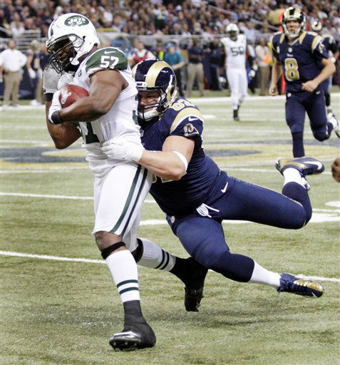 New York Jets inside linebacker Bart Scott &#40;57&#41; is pulled down by St. Louis Rams tight end Matthew Mulligan after recovering a fumble by quarterback Sam Bradford &#40;8&#41; and running it back 38-yards during the second quarter of an NFL football game, Sunday, Nov. 18, 2012, in St. Louis. &#40;AP Photo&#47;Tom Gannam&#41; <span class=meta>(AP Photo&#47; Tom Gannam)</span>