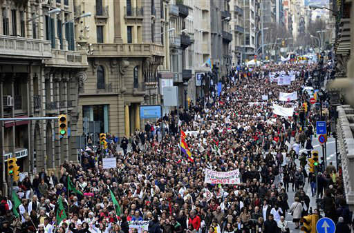 "<div class=""meta image-caption""><div class=""origin-logo origin-image ""><span></span></div><span class=""caption-text"">Health workers protest against the austerity measures in Barcelona, Spain, Sunday, Feb. 17, 2013. Thousands of people marched in different cities of Spain on Sunday to protest plans to privatize parts of their public health care system, with some questioning the motives behind the government's actions. The march by employees and users of the system is the year's second large ""white tide"" demonstration, named after the color of the medical scrubs many protesters wear. The banner reads in Spanish: ""We are health workers"". (AP Photo/Manu Fernandez) (AP Photo/ Manu Fernandez)</span></div>"